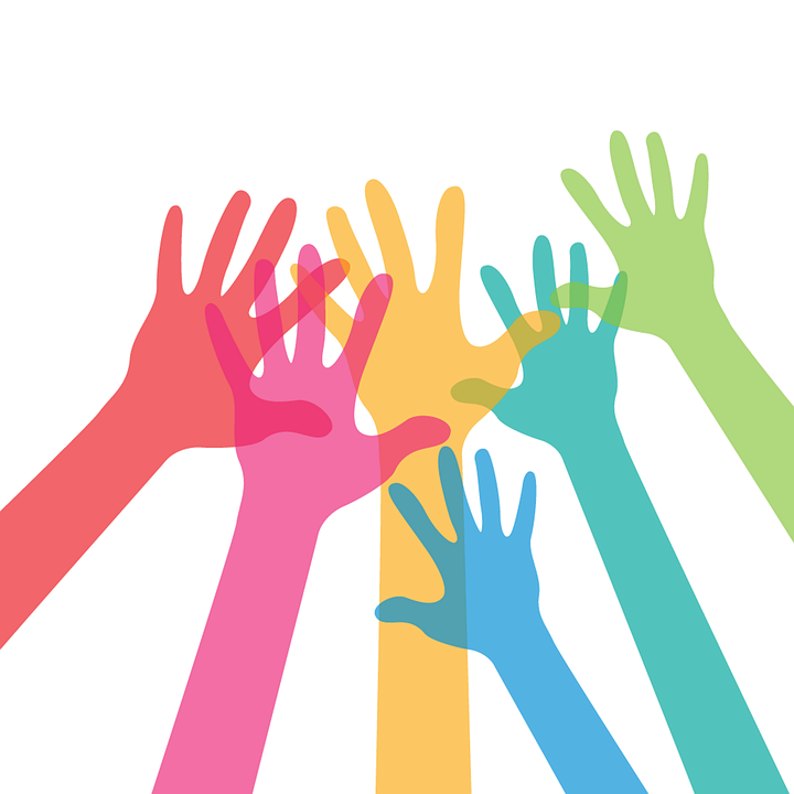 colourful hands reaching up together